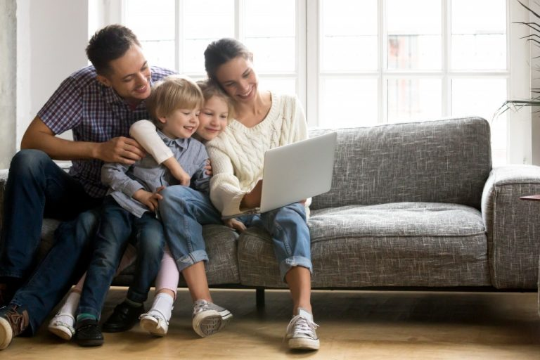 family watching from the laptop