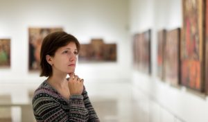 woman looking at an art gallery