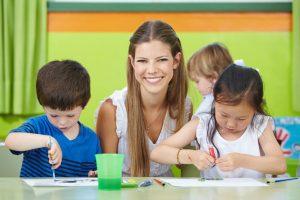 woman teaching kids art painting