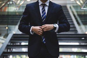 businessman buttoning suit