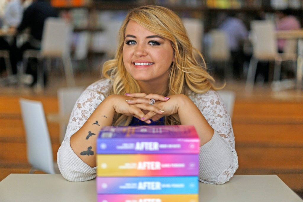 Anna Todd with her books