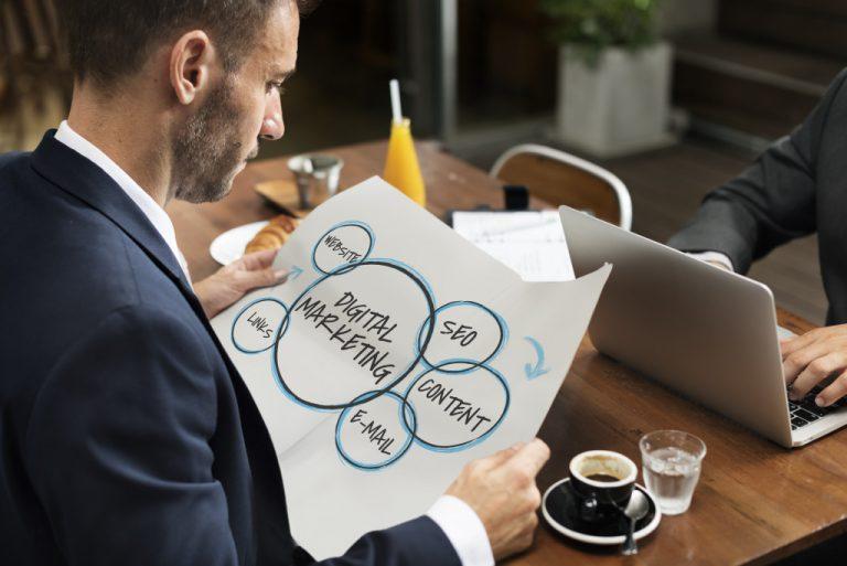 man holding digital marketing chart