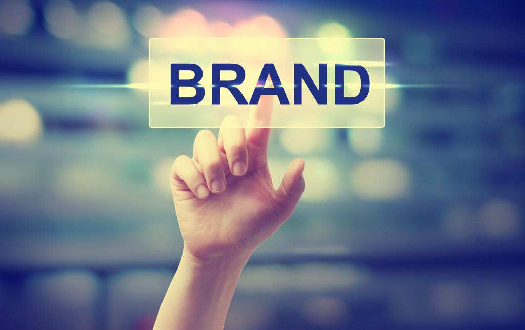 hand touching brand graphic