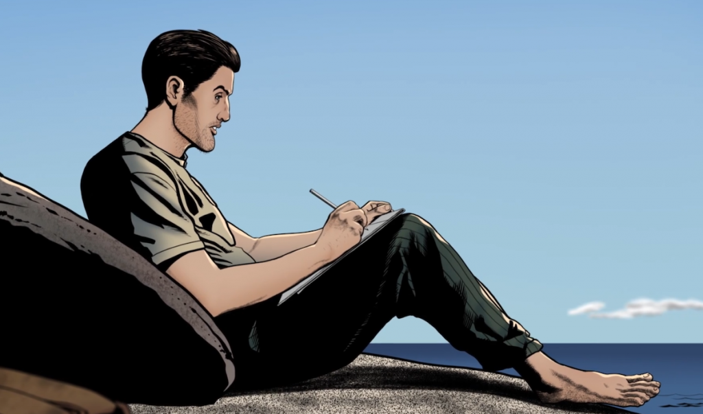 Man sitting by the beach writing on a piece of paper